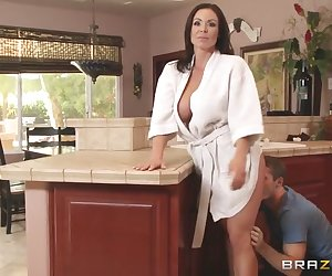 Brick Danger spent the night at his girlfriend Jackie's place, and now he's got to sneak out of the house before her dad sees him! When he almost gets caught, he dives into the first door he sees to avoid detection. Only problem is, Jackie's mom Kendra Lust is right there wearing nothing but a sexy red thong! To teach her daughter a lesson about bringing boys home, Kendra decides to try out Brick's huge cock with a blowjob on the stairs, and then he worships her tits and eats her ass while hes just feet away from Kendra's whole family! Once they're finally alone, Kendra rides that dick in every position, cumming all over it and then taking a big facial!