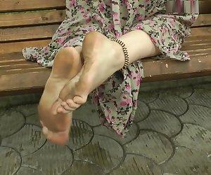 Jenya barefoot in city 4