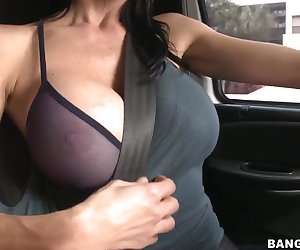she is ready for something really spicy and while driving the car shows off her nice juicy boobs, how awesome they look in this top and bra, take it off, babe for better look!