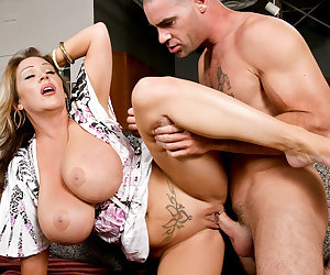 Miss Cox comes to see Charles unexpectedly because she is scared about the poor health of her son.  She wants him to train him because Charles is in such good shape.  She is very emotional, and when she feels Charles young, hard body, she just can't help herself.  This horny MILF needs a workout of her own!