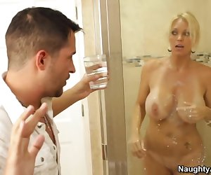 Kris has come to pick up his friend, Joey, for the game and Kris still thinks he's in the shower. So he flushes the toilet, runs some water, and gets a glass of cold water ready to spill on his friend. He walks into the shower and then realizes it's his friend's mom, Ms. Chase. Embarrassed he tries to leave for the game but Ms. Chase knows he's already probably missed it. So why not have some fun in the shower with her instead?