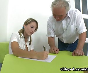 Kira is a struggling student in her teachers class and her teacher wants to help. She works a deal to fuck him for a better grade. He removes her top and sucks her breasts with his mouth. After undressing her fully, she gets on her knees to give him a blowjob. He wants her shaved pussy and fucks her from the side and while she is on top of his body, bouncing off his cock. He fucks her from behind to hold her in his arms and then she finishes him while on her knees, taking his cum all over her lips and mouth.