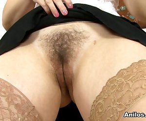 UK babe Amber Lustfull is one hot mama! Lifting her miniskirt to reveal her lack of panties and settling on the desk, Amber presses her fingers to her hairy pussy