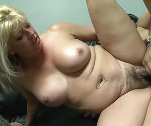A curvy blonde with a tattoo licked the guy's ass, gave a Blowjob and allowed him to do cunnilingus. Then the guy fucked her and poured the sperm on her hairy pussy
