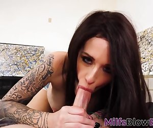Tattooed cougar sucks long dong and gets face cum sprayed over