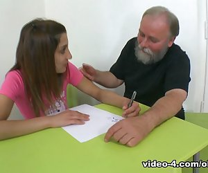 Ulia is a sexy and sexy student who is struggling in her teachers class. She reaches a deal with her older teacher to have sex with him for a better grade. He removes her pink top and begins to suck her breasts and get her horny. He then spreads her legs wide open and licks her wet pussy with his tongue. She thanks him with a slow and sexy blowjob and enjoys his cock. He wants to fuck her hard, and fucks her shaved pussy hard and she rides his cock with pleasure. She finishes with her teachers cum all over her breasts and body plus a better grade.
