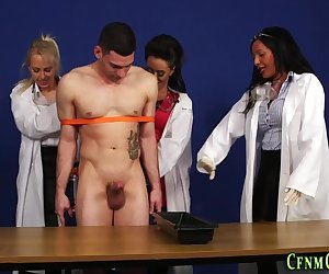 Clothed scientists sucking naked subjects dick and giving handjob